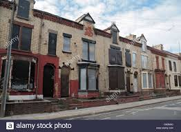 a line of boarded up houses on lothair road anfield liverpool