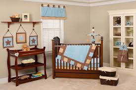 bedroom wooden cribs brown and blue blanket wooden rack rattan
