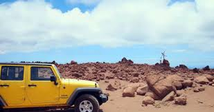 yellow jeep on beach dollar lanai