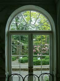 blind u0026 curtains elegant green arched window american style