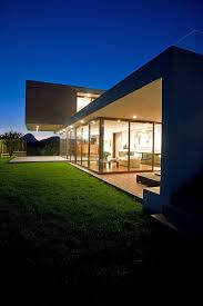 decorating modern house with concrete and floor to ceiling glass