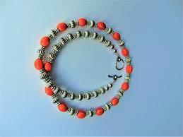 jewelry design handmade ceramic orange and silver beads bracelet
