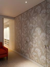 home dzine bedrooms dress up closet doors with fabric wallpaper