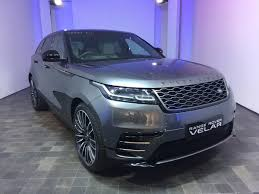 land rover velar blue minimalism the theme in design of range rover velar behind the wheel