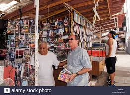 a street vendor selling pirated dvd movies shows a variety of new