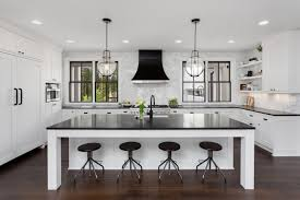 white kitchen cabinets with granite countertops photos opposites attract white cabinets black granite how to