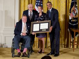 point of light award hatch watches as obama honors george h w bush s points of light