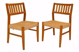 pair of mid century modern teak dining room chairs by sun cabinet