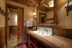 rustic bathroom present trough sink and unique vanity lighting