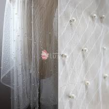 fabric tulle ivory sheer rhombus tulle fabric with pearl sold by the yard