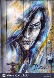 Spray Paint Artist - spray paint artist paints mural at sausalito free concert stock