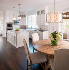 light above table kitchen traditional with upholstered chairs