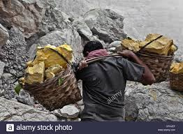 Sulphur Smell In Basement Sulfur Workers At Kawa Ijen Volcano In The Sulfur Mine Kawa Ijen