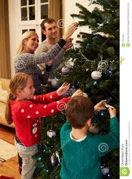 At Home Christmas Trees by Family Decorating Christmas Tree At Home Together Stock Photo