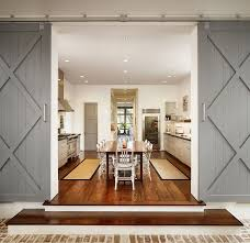 Salvaged Barn Doors by Kitchens Mediterranean Kitchen With Red Rug Also Wood Island And