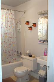 small kid bathrrom with white acrylic tub and plastick shower wery tiny bathroom