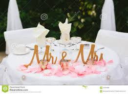 bride and groom wedding reception table decor stock photo image