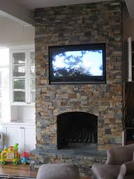 brown stacking natural stone wall fireplace with natural fireplace