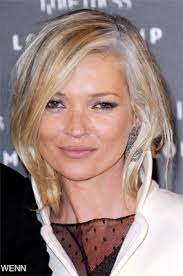 grey streaks in hair ooh i ll have a few grey highlights please emma hill