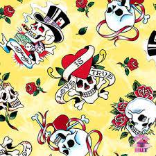 145000042 ed hardy is true yellow skulls fabric by yard