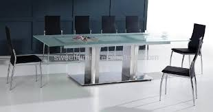 large glass top dining table glass and stainless steel dining table sustainablepals org