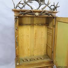 Wood Gun Cabinet Online For Sale An Antique Antler Gun Cabinet