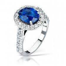 engagement ring uk blue sapphire and diamond cluster engagement ring in platinum