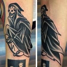 funny looking old black ink forearm tattoo of death skater