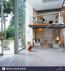 large open floor plans home office on floor above living room in large open plan stock