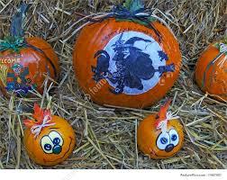 halloween scenes picture of painted pumpkins