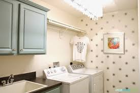 White Laundry Room Cabinets by A Year Of Change Laundry Room Reveal Life On Virginia Street