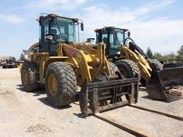 caterpillar 838h wheel loader with forks on the front the 938f
