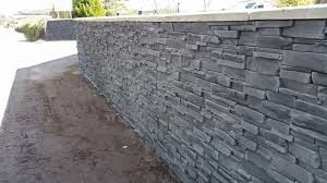 stone effect garden wall and front house deco stones