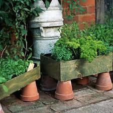 Urban Herb Garden Ideas - container gardening growing vegetables in urban planters