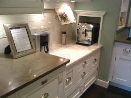 quartz countertops cream colored kitchen cabinets lighting