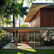 patio house long glass house with folding wooden facade