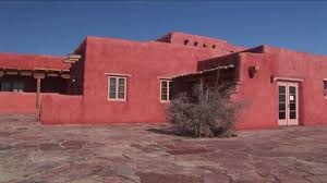 Pueblo Adobe Houses by An Adobe House Occupies A Desert Plain In New Mexico Stock Video
