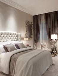 Elegant Bedroom Features A Linen Tufted French Chaise Lounge Next - Elegant bedroom ideas