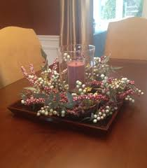 Table Flowers by Dining Room With Flowers And Candle On Square Plate Table