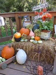 fall themed corner deck yard decoration with pumpkins arrangement