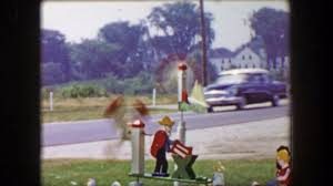 1955 windmill yard decoration man sawing wood americana style