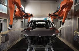 bmw factory robots learning to prosper in a factory town mit technology review