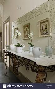 decorative mirror and antique french wrought iron console in