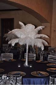 ostrich feather centerpieces vase ostrich feather centerpiece white linens and events