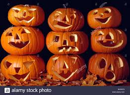 carved pumpkins stacked on each other for halloween scare indoors