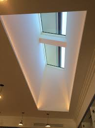skylight and light well with led strips hidden along the two long