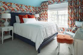 bedroom with pops of orange transitional bedroom
