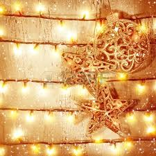 New Years Eve Door Decorations by Golden Christmas Baubles Hanging On Wooden Door Decorated With