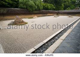 famous zen rock garden at ryoanji temple kyoto japan stock photo