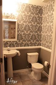 small downstairs bathroom like the wallpaper and chair rail idea bathroom with bird wallpaper and yellow floor